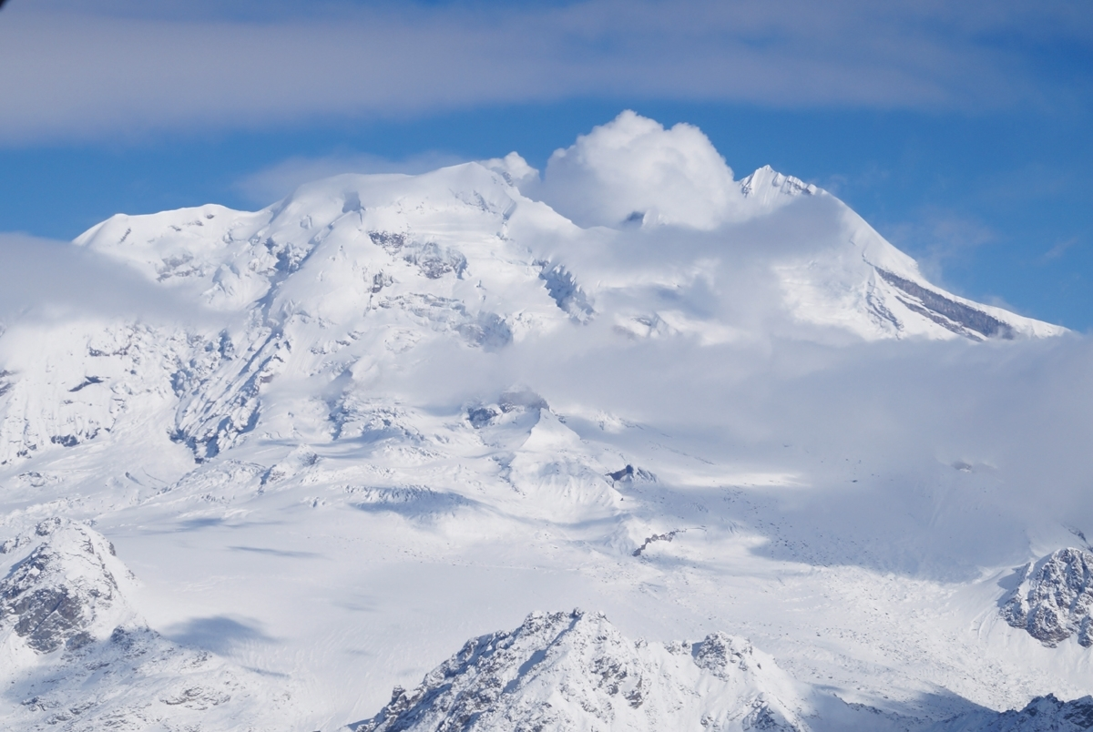 <b></b> Mount Redoubt Volcano is located just west of Cook Inlet, in the Kenai Peninsula Borough in Alaska. Note the steam coming out &#x2014; it&#x2019;s not a cloud. ({Paul Benoit photo)