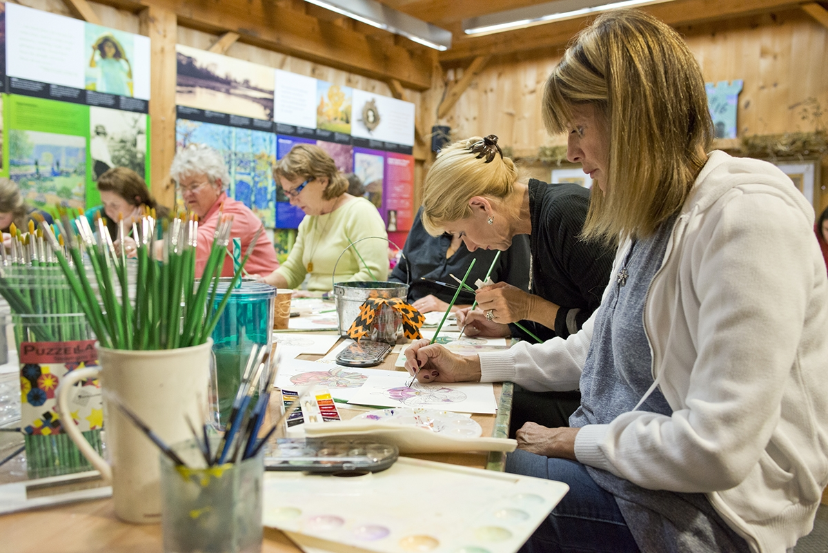 <b></b> Gretchen Highsmith paints a watercolor of a ferry during Art Barat the Florence Griswold Museum in Old Lyme. (Peter M. Weber photo)