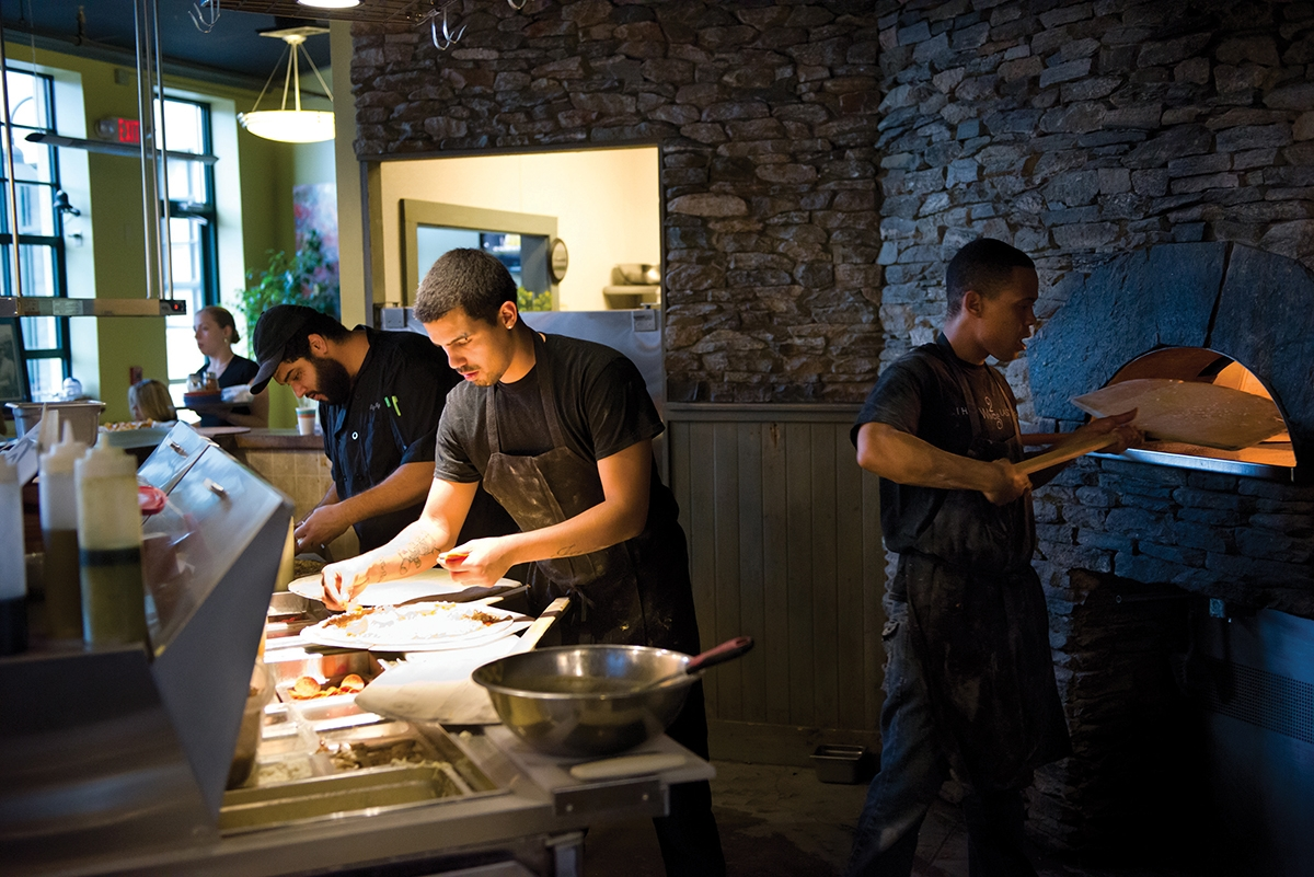 The distinctive wood stone  oven at 2Wives resaurant  in New London is the heart of  the thriving eatery. (Peter M. Weber photo)