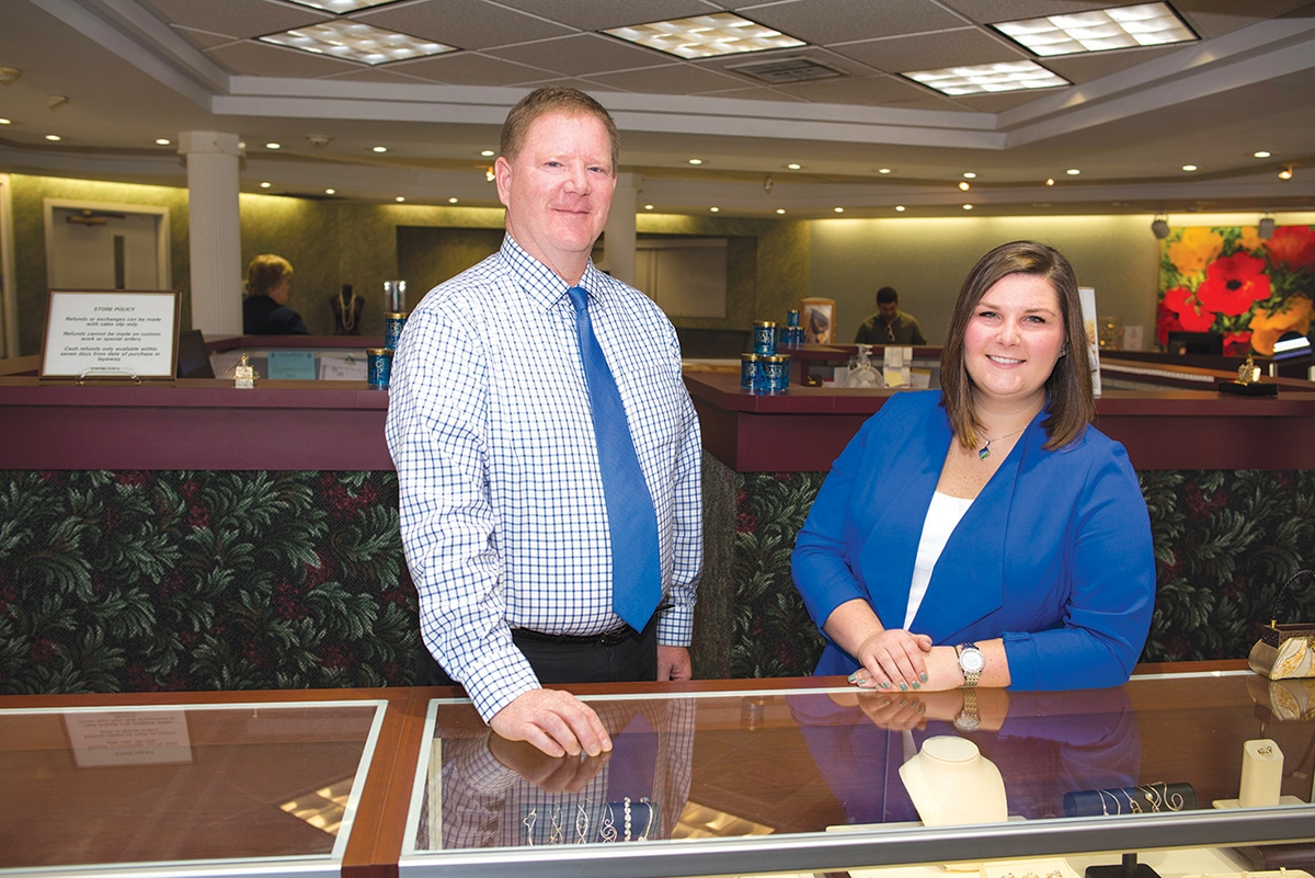 <b></b> Mark Grader and daughter Andrea greet customers at Grader Jewelers' Groton location. (Peter M. Weber photo)