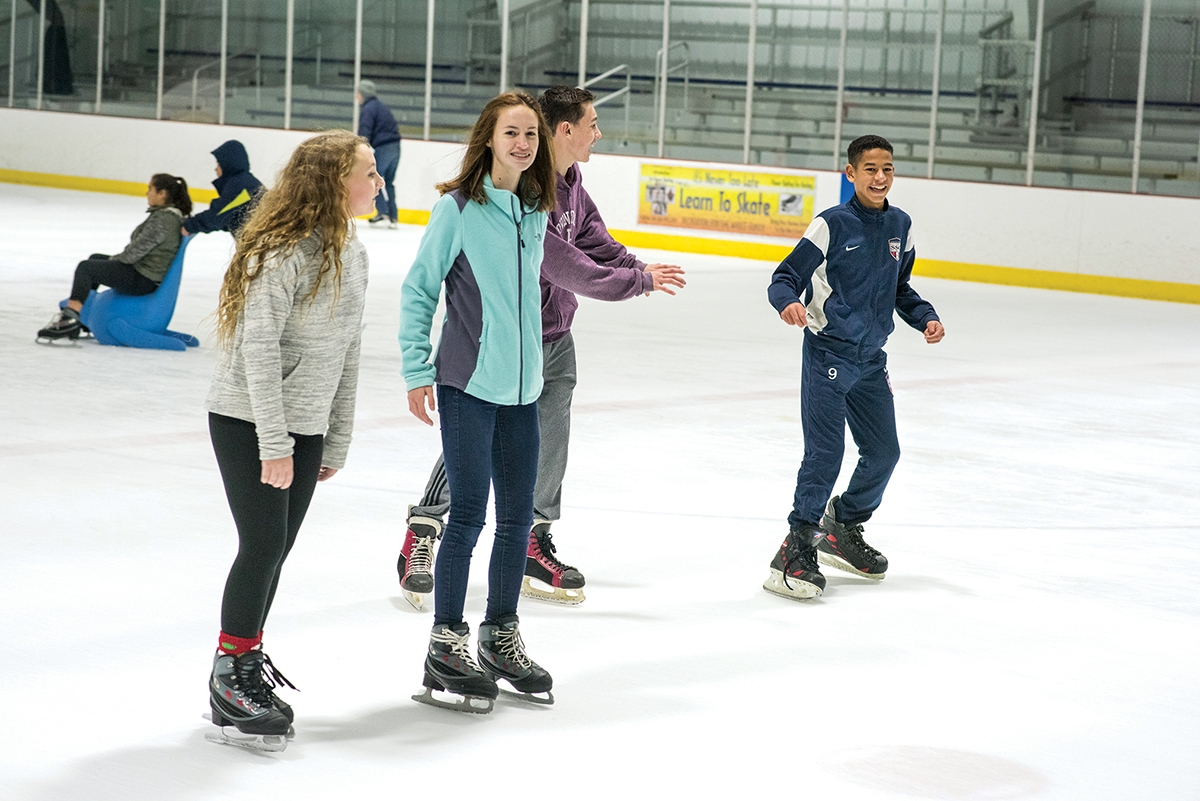 <b></b> From left, Rylee Grovor, Teia Lee, Joey Burton and Daimon Pollard enjoy time during public skate at Rose Garden Ice Arena. (Peter M. Weber)