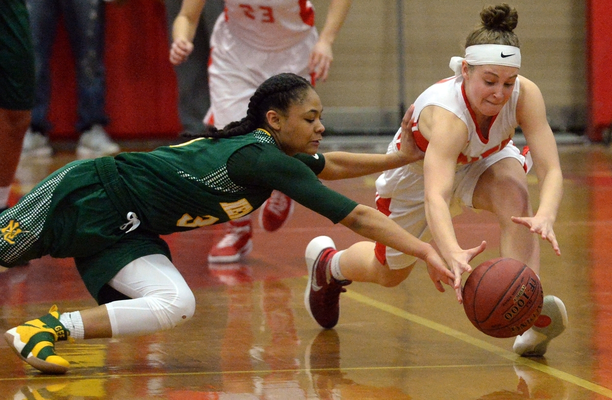 <b></b> New London's Jada Lucas, left, and NFA's Kayley Ericson dive for a loose ball during a Feb. 14 game at NFA. The two rivals, who play tonight for the ECC Division I title (on theday.com), are on opposite sides of the CIAC Class LL girls' basketball tournament bracket and can only play for the fourth time this season if they reach the championship game on March 18 of 19 at Mohegan Sun Arena. (Dana Jensen/The Day)