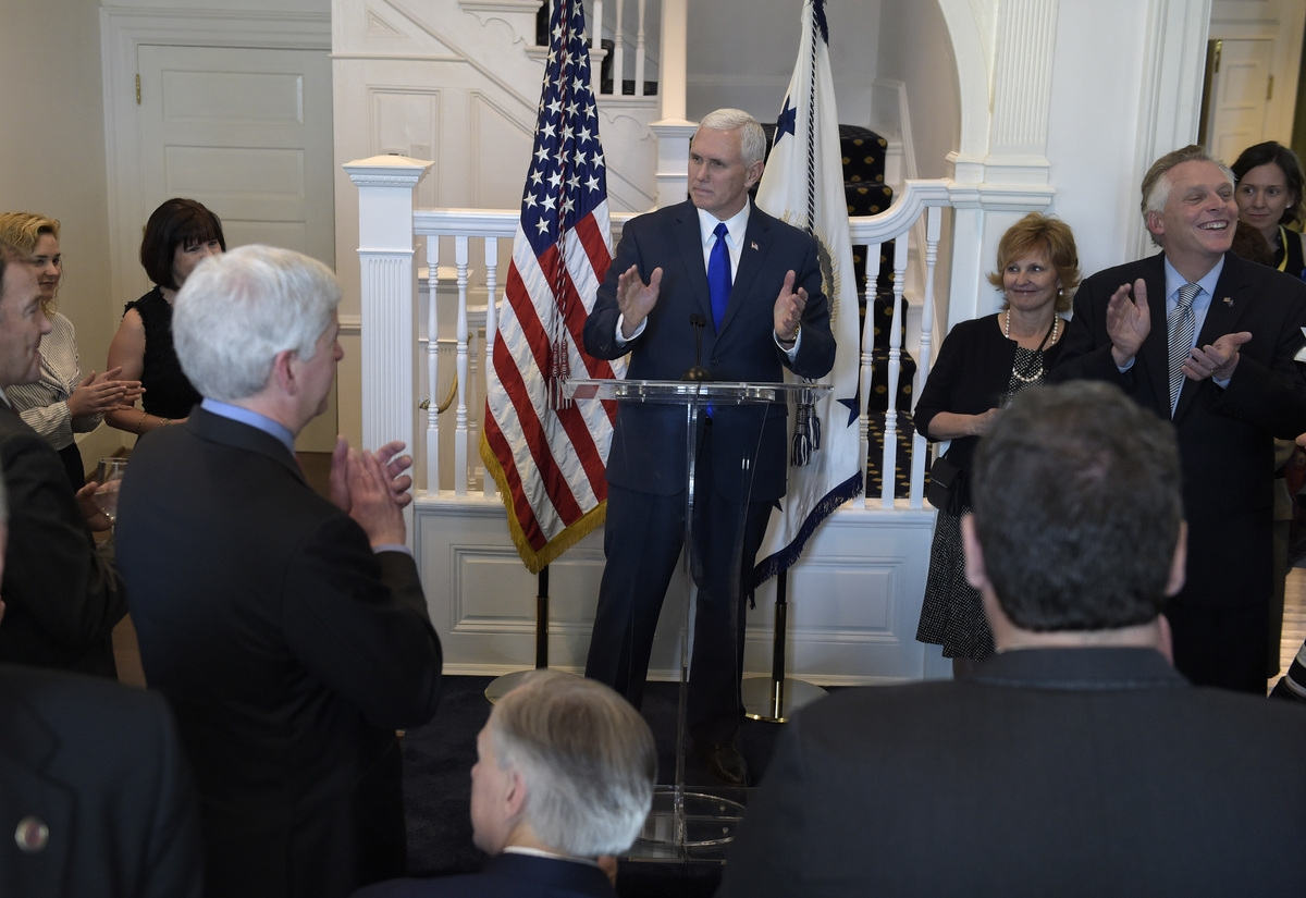 <b></b> Vice President Mike Pence welcomes governors to the Naval Observatory Washington, Friday, Feb. 24, 2017. Michigan Gov. Rick Snyder is at left, Virginia Gov. Terry McAuliffe is at right. (AP Photo/Susan Walsh)