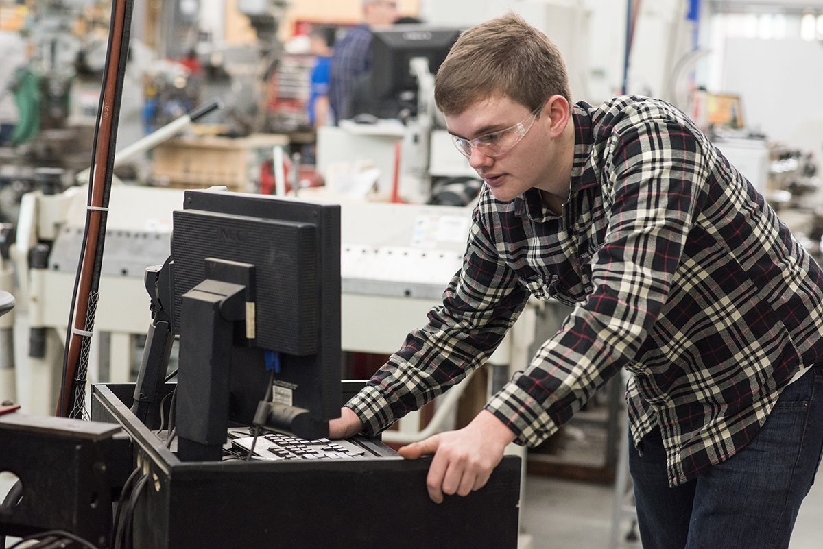 <b></b> Sam Frankel looks at the monitor controlling the plasma cutter. (Peter M. Weber photo)