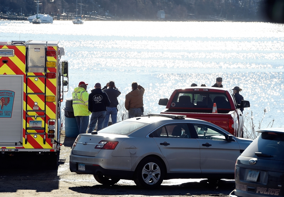 <b></b> Searchers scan the waters from the command post during a search for missing kayaker Lyle Dagenais on Feb. 20, 2017, in Montville. Police believe a body recovered near the Naval Submarine Base on Tuesday, March 21, 2017, might be that of Dagenais.  (Sean D. Elliot/The Day)