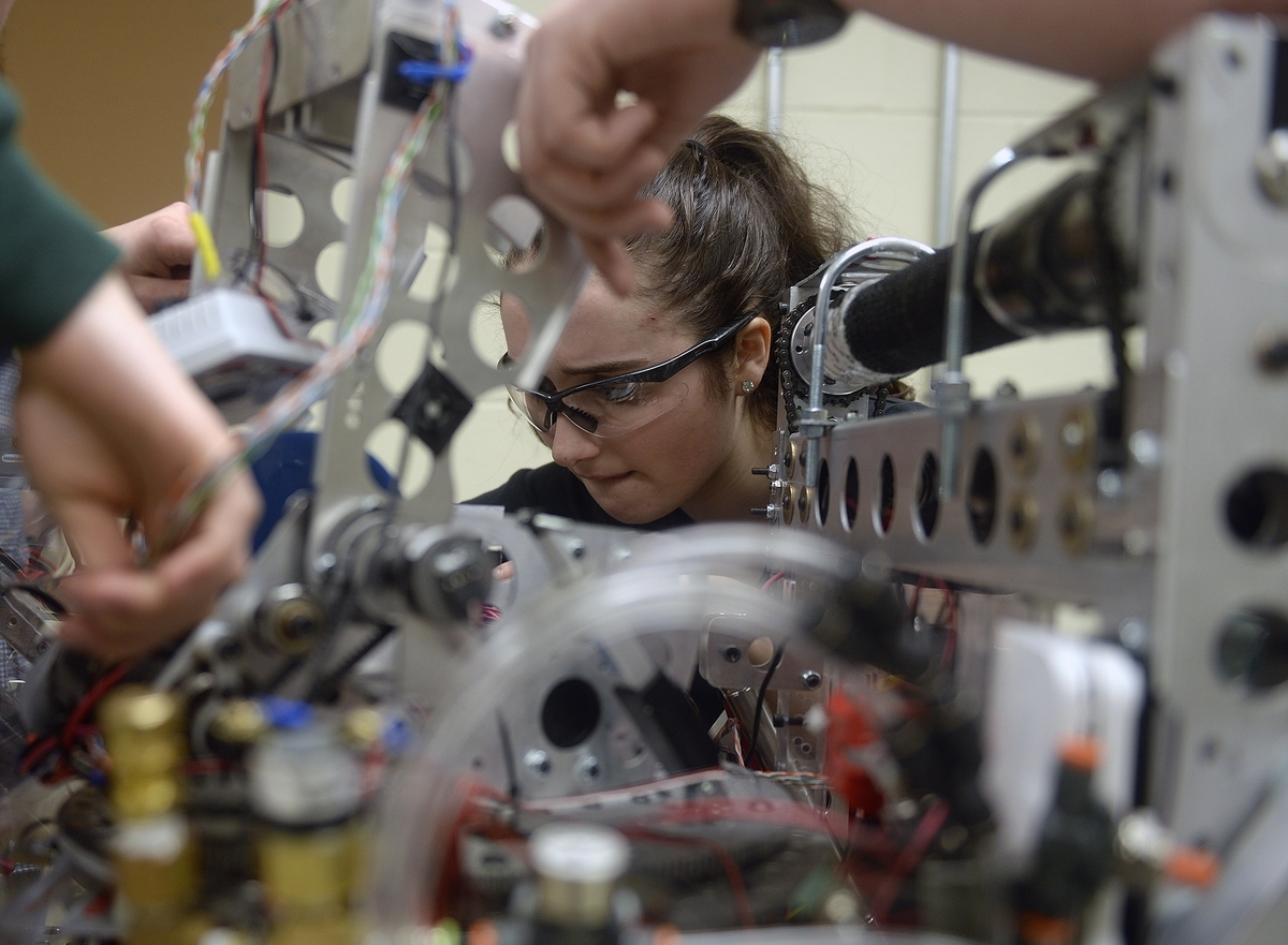 <b></b> Sophomore Julianna Ziegler, concentrates as she works on a robot on Thursday, March 23, 2017, at Robert E. Fitch High School in Groton.  The