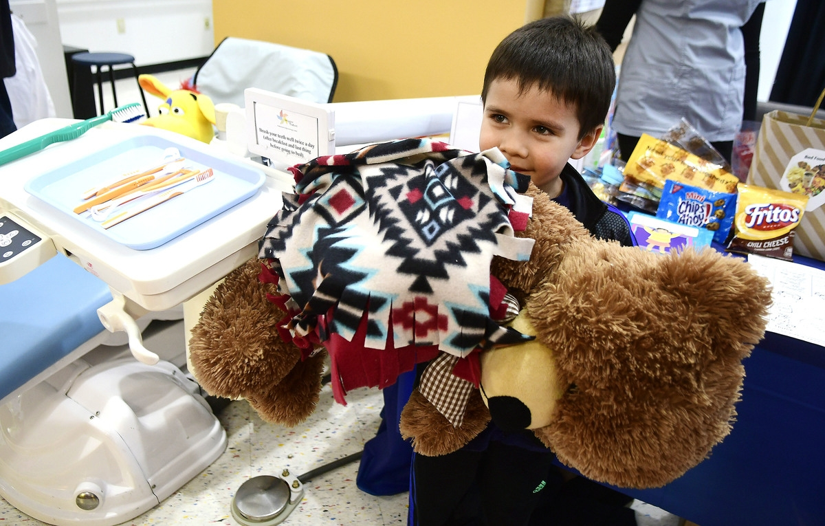 <b></b> In a March 11, 2017, photo, Antonio Ruiz plays with his giant bear Teddy during the Imagine Nation Museum Early Learning Center's Teddy Bear Clinic held in Bristol, Conn. (Mike Orazzi/The Bristol Press via AP)