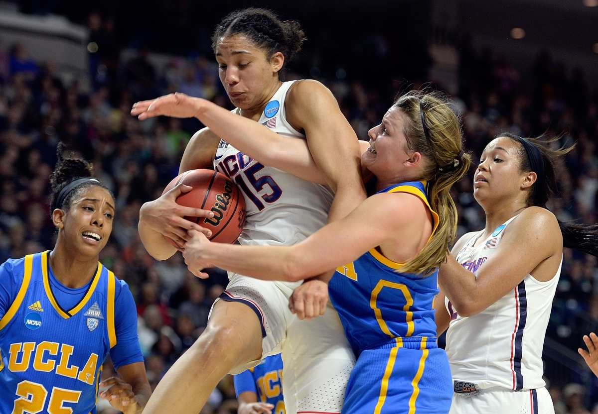 <b></b> UConn&#x2019;s Gabby Wililams pulls down a rebound between UCLA&#x2019;s Monique Billings, left, and Kari Korver during Saturday&#x2019;s Bridgeport Regional semifinal at at Webster Bank Arena. Williams had 17 points, nine rebounds and six assists as the top-seeded Huskies defeated the No. 4 Bruins 86-71 to advance to Monday&#x2019;s regional final against Oregon. (Sean D. Elliot/The Day)