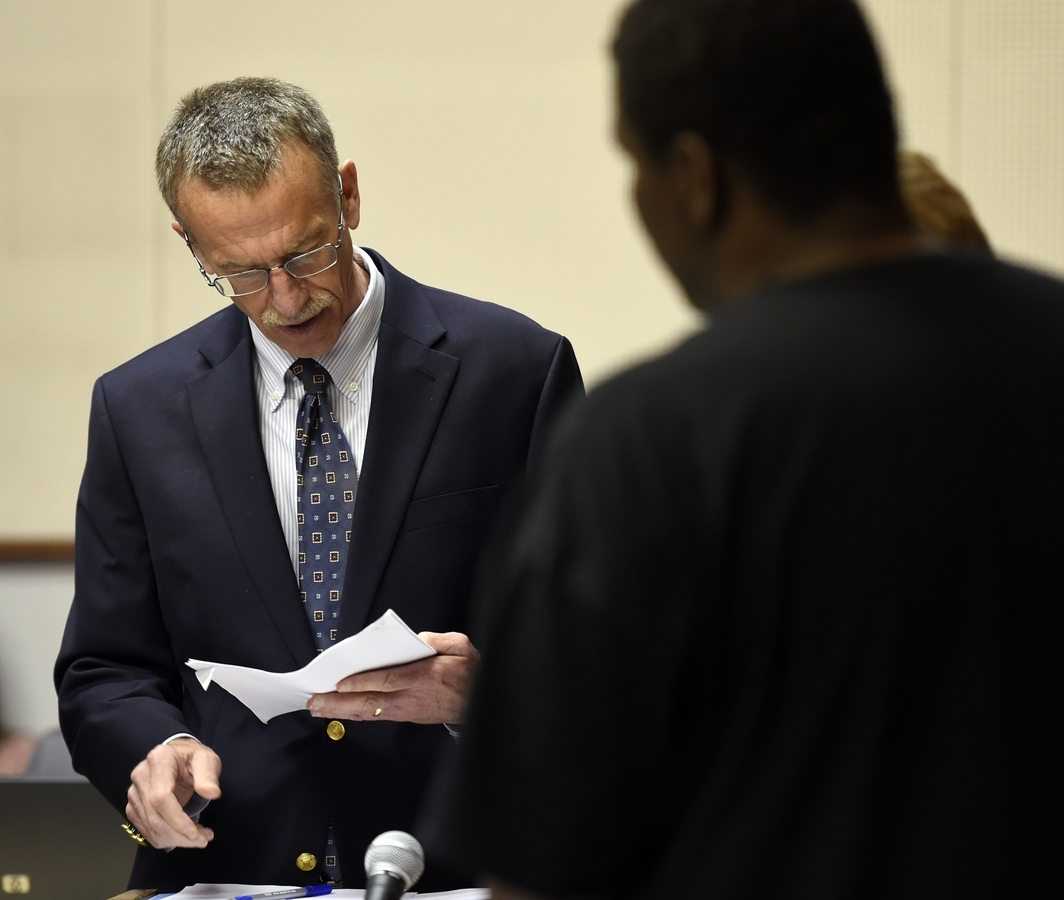 <b></b> In this May 2014 Day file photo, Prosecutor Michael Kennedy, left, reads off charges against Lance Goode right, before Judge Kevin McMahon on Hindering Prosecution and Tampering with a Witness charges related to the August 2013 murder of Jesus