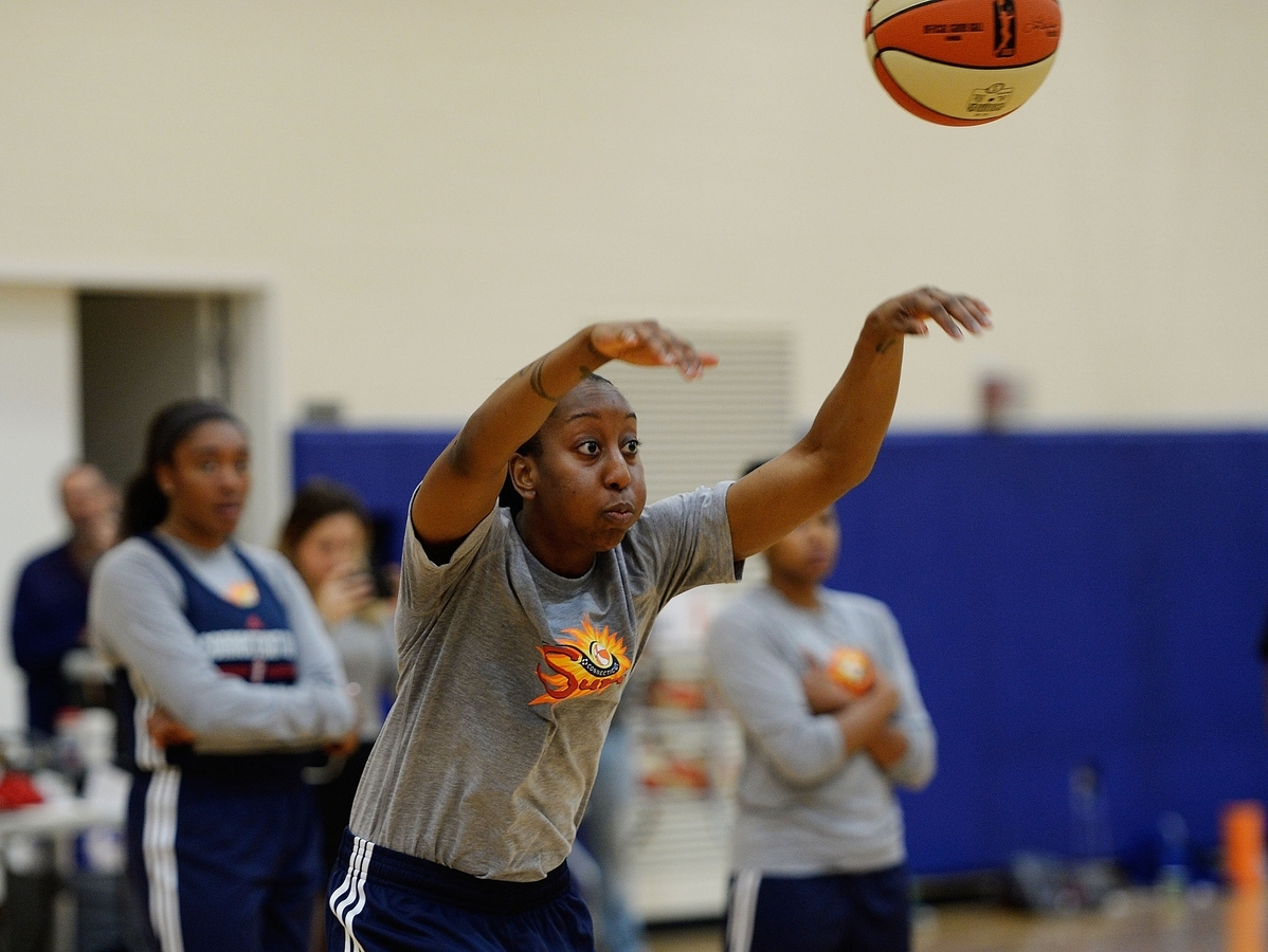 <b></b> Allison Hightower of the Connecticut Sun runs the offense on the first day of preseason practice earlier this week at the Mohegan Tribal Community Center. The Sun open their regular season May 14 at Chicago. (Sean D. Elliot/The Day)