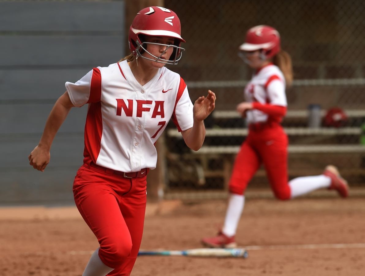 <b></b> Norwich Free Academy's Beth Fleming (7) runs towards first base with teammate Jordan Nute, background, scoring on Fleming's RBI single during a 15-0, six-inning win over Tourtellotte in Wednesday's quarterfinals of the ECC tournament at Veterans Field in Niantic. (Dana Jensen/The Day)