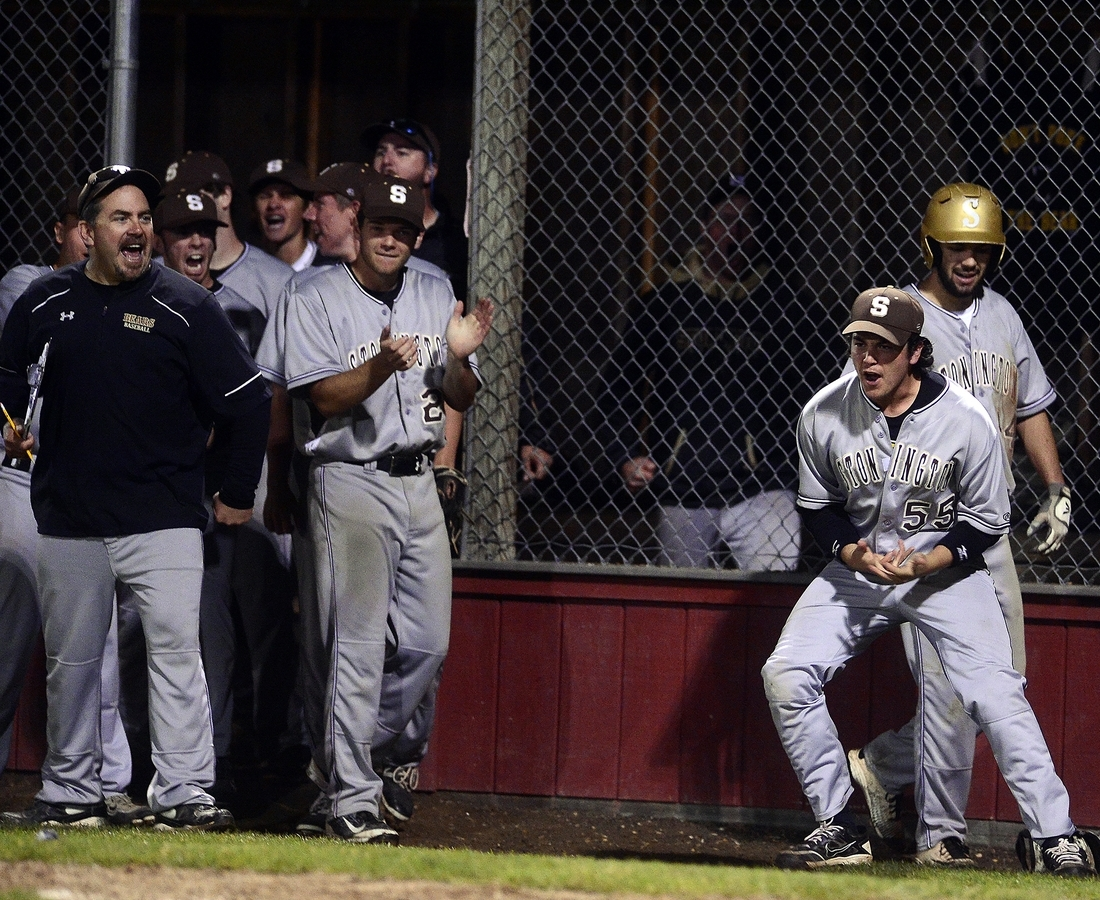 <b></b> Stonington&#x2019;s Ben Potenziano (55) and teammates react from just outside the dugout after the fifth-seeded Bears scored a run during their 11-7 victory over No. 3 East Lyme in eight innings Friday night in the Eastern Connecticut Conference baseball tournament championship game at Fitch High School. (Sarah Gordon/The Day)
