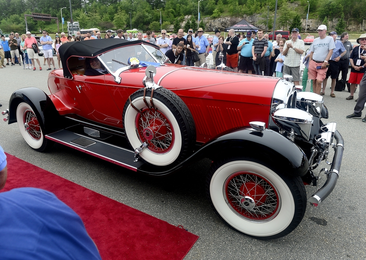 <b></b> Barbara Mason smiles out the window of a 1928 Auburn Speedster driven by her husband Al, both of Virginia, during the New England Concours D'Elegance on Sunday, June 18, 2017 at Mohegan Sun.  The model 8-115 won Best in Show during the car show. (Sarah Gordon/The Day)