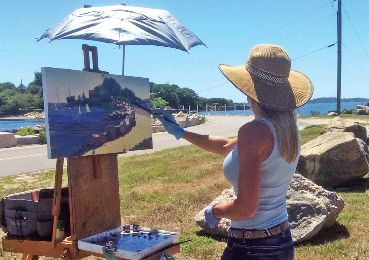 <b></b> Jacqueline Jones paints at Enders Island. (Submitted photo)