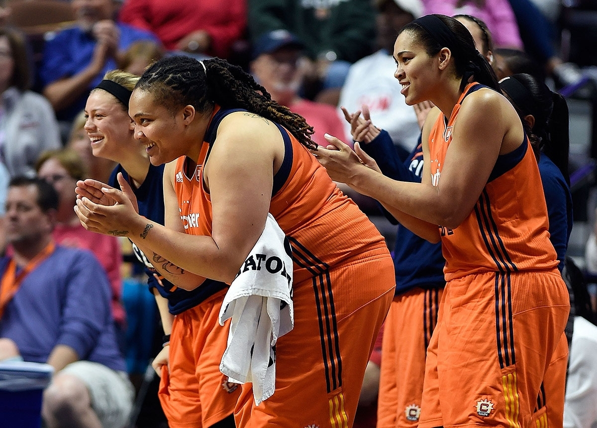 <b></b> The Connecticut bench, from left, Rachel Banham, Danielle Adams and Brionna Jones, cheer from the sideline during a game against the New York Liberty on June 14 at Mohegan Sun Arena. Coach Curt Miller said team chemistry, including players on the bench, is a major reason why the Sun have won four straight and five of their last six games after starting 0-4. (Sean D. Elliot/The Day)
