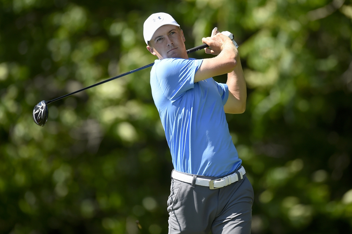 <b></b> Jordan Spieth follows his tee shot on the 12th hole during the first round of the Travelers Championship on Thursday at TPC River Highlands in Cromwell. Spieth, playing in the tournament for the first time, fired a 7-under 63 to take the first round lead. (John Woike/Hartford Courant via AP)