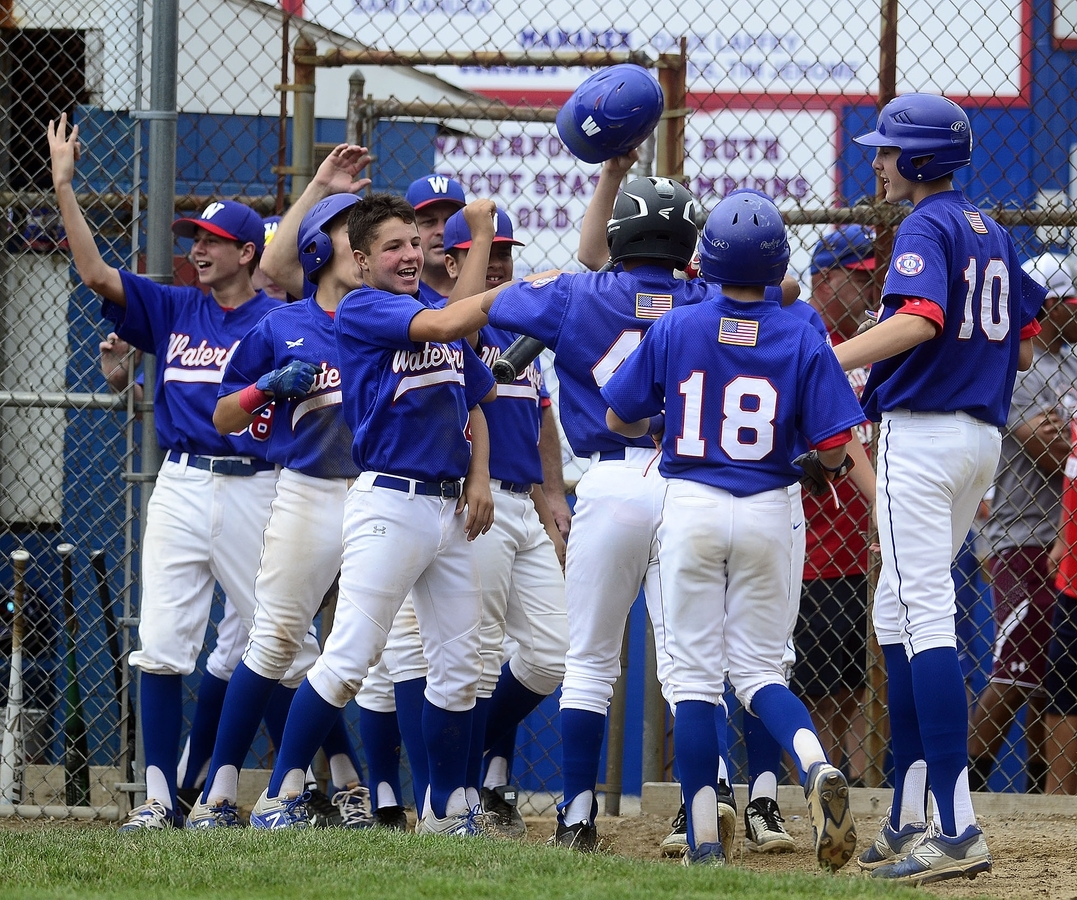 <b></b> Waterford players celebrate in front of the dugout after scoring one of its four runs in the third inning of Saturday's 4-1 win over Trumbull in the Connecticut Babe Ruth 14-year-old baseball tournament championship on Saturday. (Sarah Gordon/The Day)