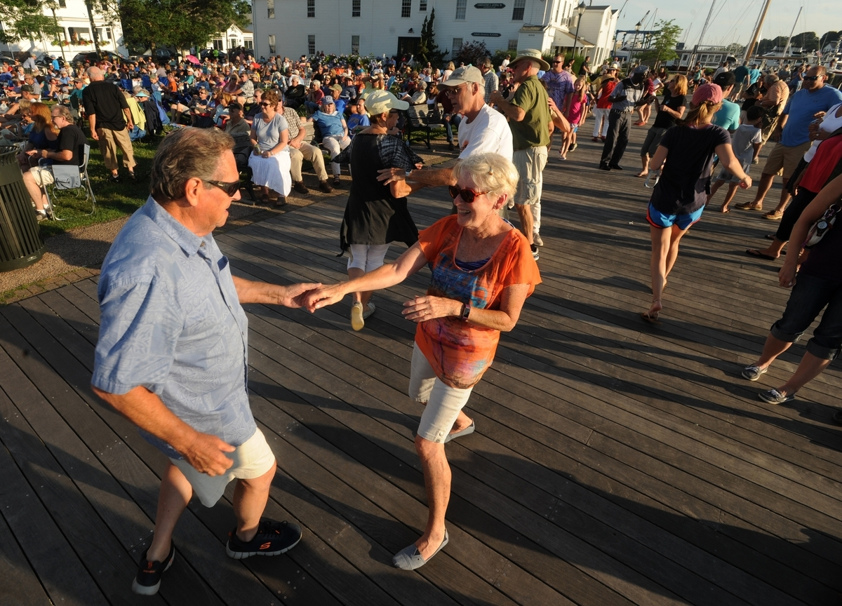 <b></b> Paul Metcalfe of Lisbon and Judy Packer-Plouffe of Niantic and others dance to the music of Kenny Neal during the Blue Monday Concert at Mystic River Park in downtown Mystic on Monday, July 17, 2017. (Dana Jensen/The Day)