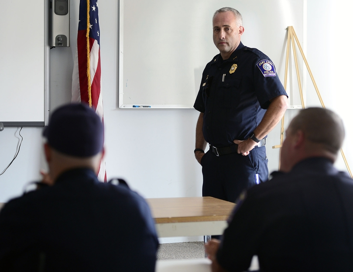 <b></b> East Lyme Police Chief Michael Finkelstein talks with his officers during roll call on Wednesday, July 12, 2017, at the department in East Lyme.  The department officially became independent on July 1, 2017. (Sarah Gordon/The Day)