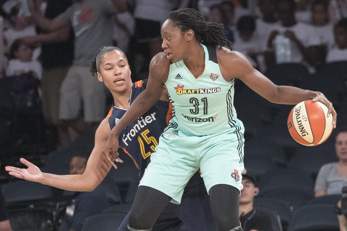 <b></b> New York center Tina Charles (31) drives to the basket against Connecticut forward Alyssa Thomas during Wednesday's WNBA game at Madison Square Garden. Charles, the former UConn All-American, had 28 points and 17 rebouinds to lead the Liberty to a 96-80 win over the Sun. (AP Photo/Mary Altaffer)