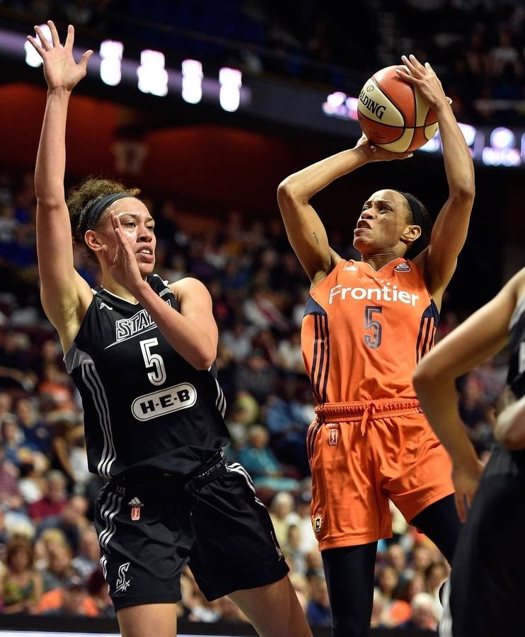 <b></b> Jasmine Thomas of the Sun puts up a shot after being fouled by Dearica Hamby of the Stars, left, in Sunday's game at Mohegan Sun Arena. (Sean D. Elliot/The Day)