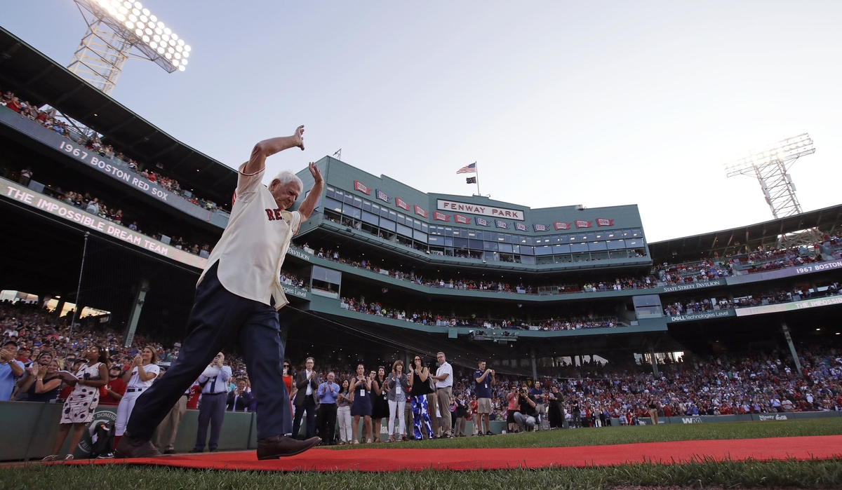 <b></b> Boston Red Sox great Carl Yastrzemski raises his arms as he is honored with teammates on the 50th anniversary of the 1967