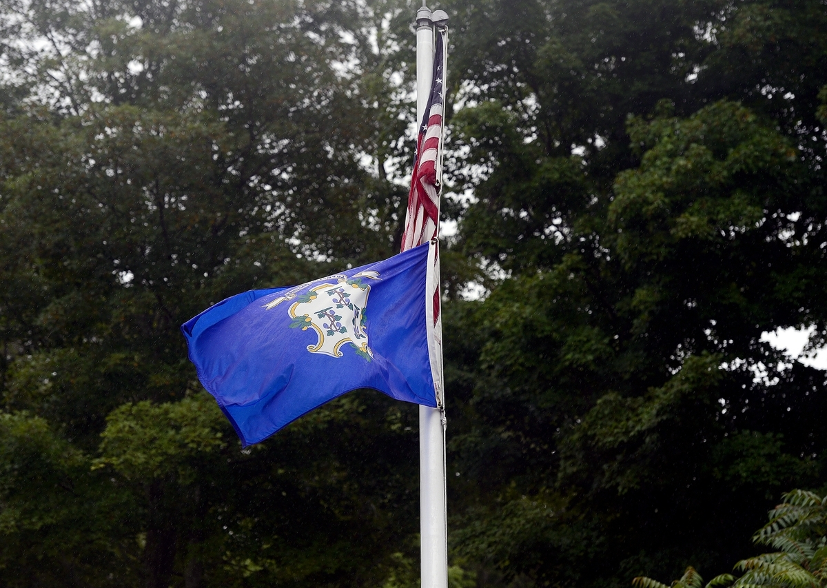 <b></b> The Connecticut state flag flies upside-down in response to the state's budget problems on Friday, Aug. 18, 2017, at North Stonington Town Hall. (Sarah Gordon/The Day)