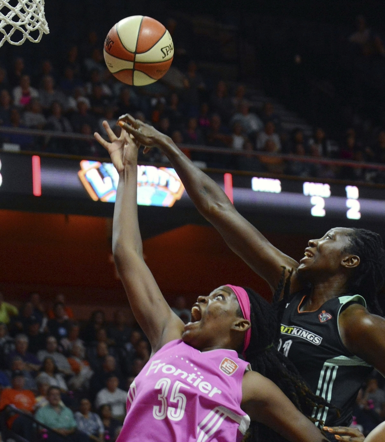 <b></b> Jonquel Jones of the Connecticut Sun shoots in front of Tina Charles of the New York Liberty during Friday's WNBA game at Mohegan Sun Arena. The Liberty won 82-70. (John Shishmanian/The Norwich Bulletin via AP)