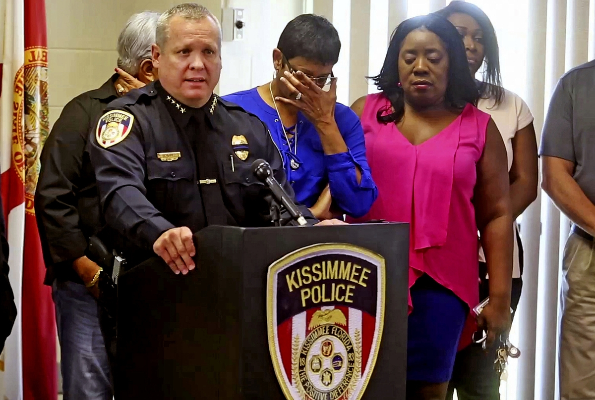 <b></b> Kissimmee Police Chief Jeff O'Dell, left, holds a news conference Saturday, Aug. 19, 2017, in Kissimmee, Fla.  The Kissimmee Police Department says Sgt. Sam Howard died Saturday from his injuries. His colleague, Officer Matthew Baxter, died Friday night after the attack in a neighborhood of Kissimmee, located south of the theme park hub of Orlando.   (Red Huber/Orlando Sentinel via AP)