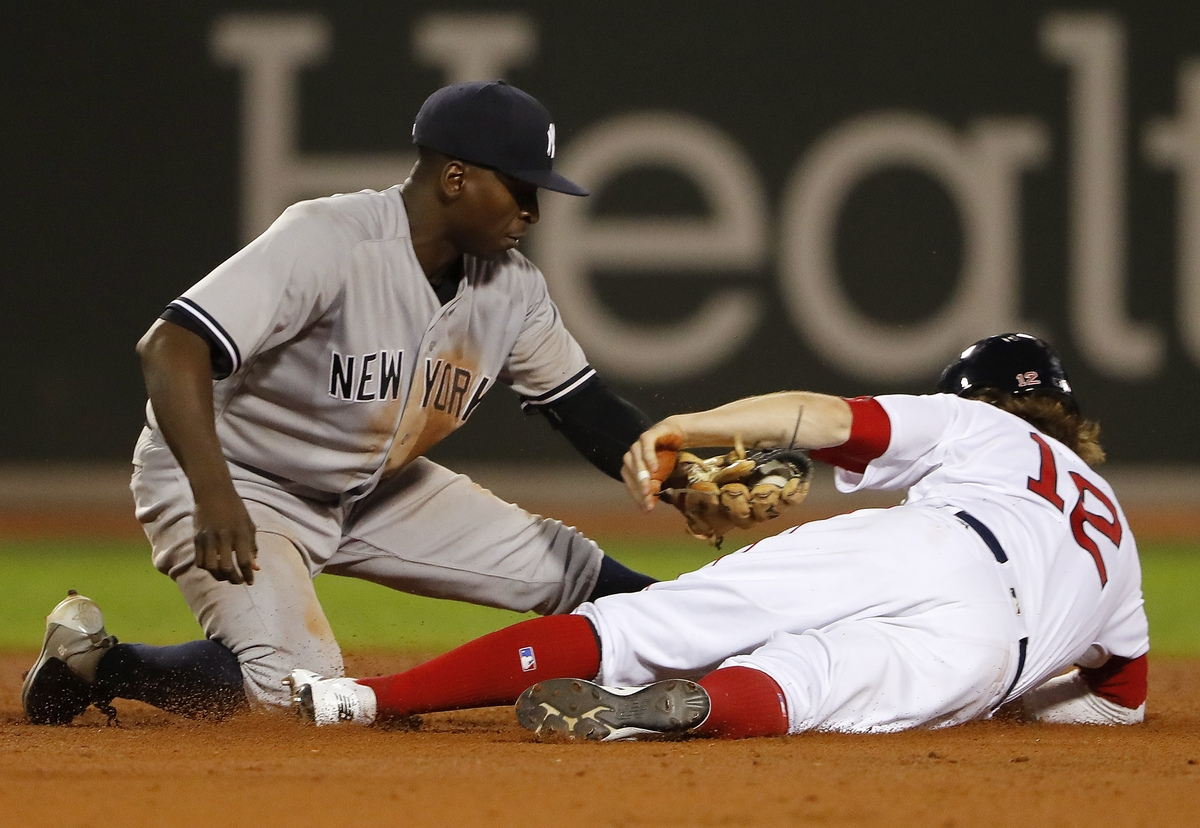 <b></b> New York Yankees shortstop Didi Gregorius tags out Brock Holt of the Boston Red Sox trying to steal second base during the ninth inning of the Yankees' 4-3 Saturday at Fenway Park. Holt, pinch running, was the second out of the inning. (Winslow Townson/AP Photo)