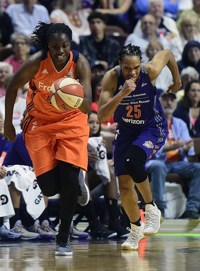 <b></b> Shekinna Stricklen of the Connecticut Sun, left, leads a breakaway past Monique Currie of the Phoenix Sun during a game Aug. 4 at Mohegan Sun Arena. Entering Saturday's WNBA schedule, the Sun lead the league with an average of 86.9 points per game. (Sarah Gordon/The Day)