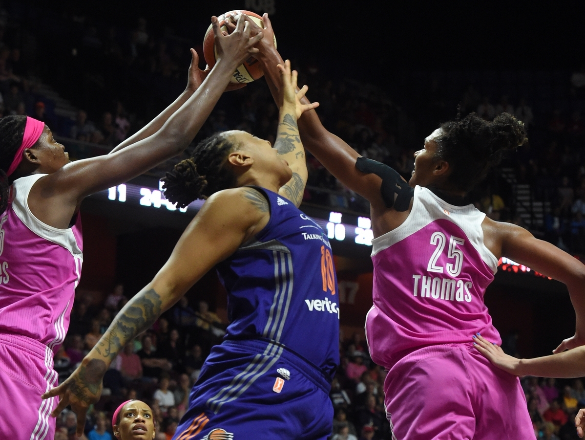 <b></b> Jonquel Jones (35) and Alyssa Thomas (25) of the Connecticut Sun grab a defensive rebound against Emma Cannon (10) of the Phoenix Mercury during a WNBA game on Sunday at Mohegan Sun Arena.  (Dana Jensen/The Day)