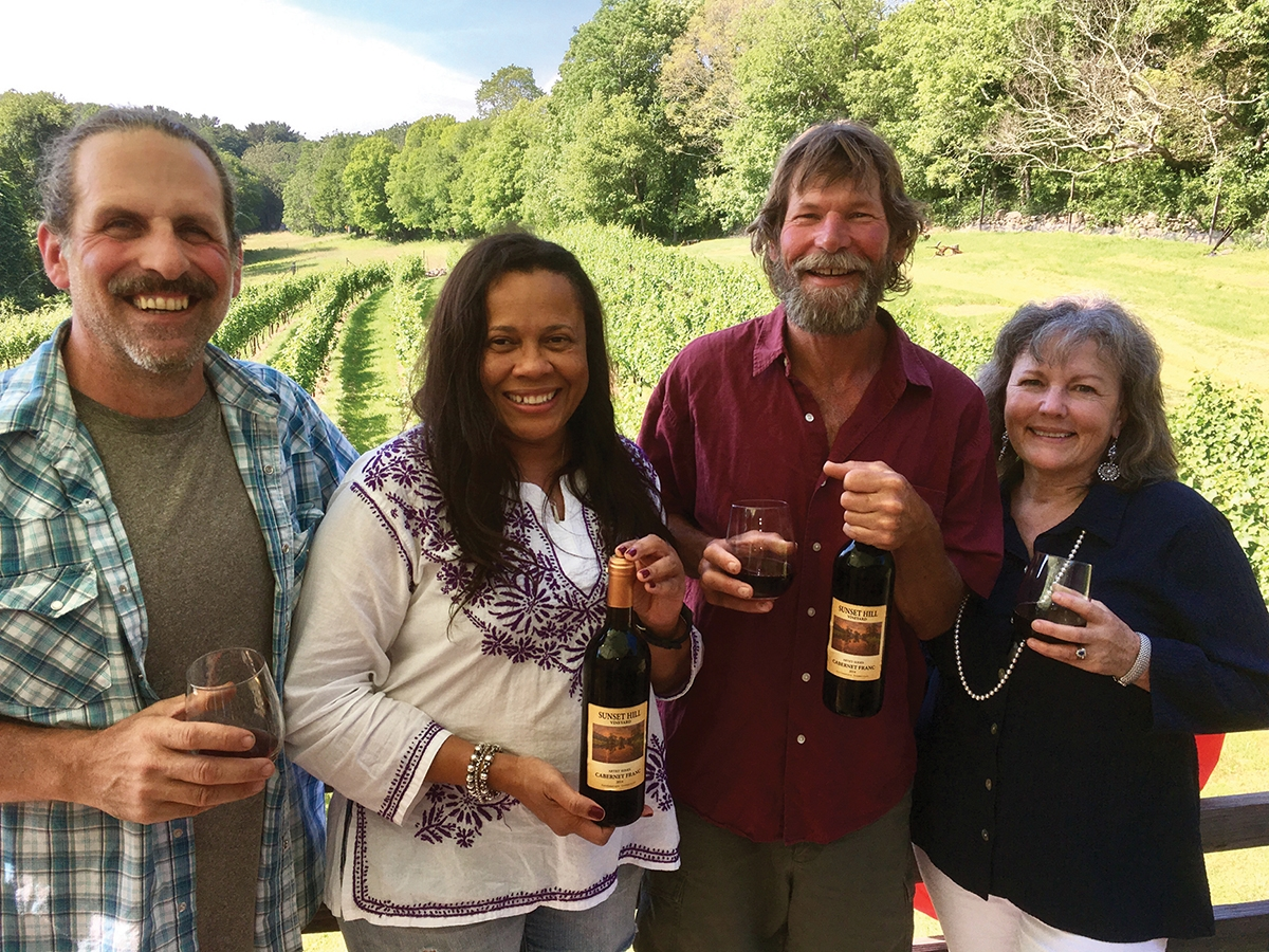 Matt Caruso and Donna Moore, winemakers and co-owners of Sunset Hill Vineyards join Leif Nilsson, elected artist, Lyme Art Association; and Jocelyn Zallinger, gallery manager, Lyme Art Association. (Submitted photo)