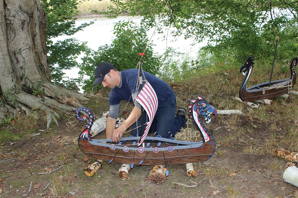 Artist Dave Graybill works on a Viking sailing ship during a previous Faerie Village event. (Photo courtesy of Florence Griswold Museum)