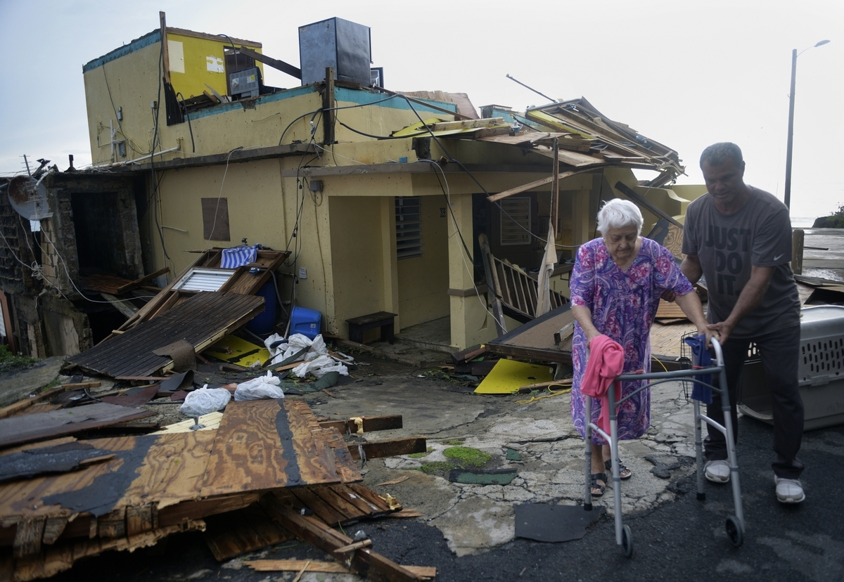 Rosa Maldonado, 87 years old is taken to a hospital Thursday, Sept. 21, 2017, after sitting in a sweltering damaged home in the La Perla neighborhood in Old San Juan after Hurricane Maria lashed the island. She and her family weathered the hurricane inside the home. (Credit Image: © Carol Guzy via ZUMA Wire)