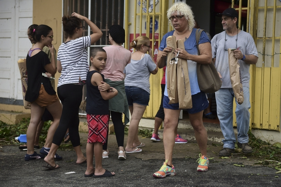 People buy bread at Ortiz bakery after the passing of Hurricane Maria, in Yabucoa, Puerto Rico, Thursday, September 21, 2017.  (AP Photo/Carlos Giusti)