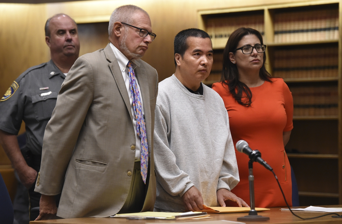 Lishan Wang, center, appears in court with Chief Public Defender Thomas Ullmann, left, during his sentencing at New Haven Superior Court Friday, Sept. 22, 2017 in New Haven, Conn.  Wang, convicted of killing a Yale University physician over a workplace dispute, has been sentenced to 32 years in prison.  The judge handed down the punishment to Wang for the 2010 shooting death of Dr. Vajinder Toor. He pleaded no contest in June to manslaughter and other charges.  (Brad Horrigan/The Courant via AP)