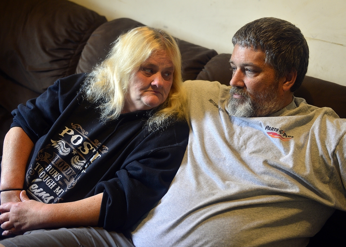 <b></b> Debra Post looks at her husband Brad as they sit in their home in Groton on Friday, September 22, 2017. The couple cared for the four children of Kirsten Fauquet at the center of a recent case with the Department of Child and Family Services.  (Sarah Gordon/The Day)