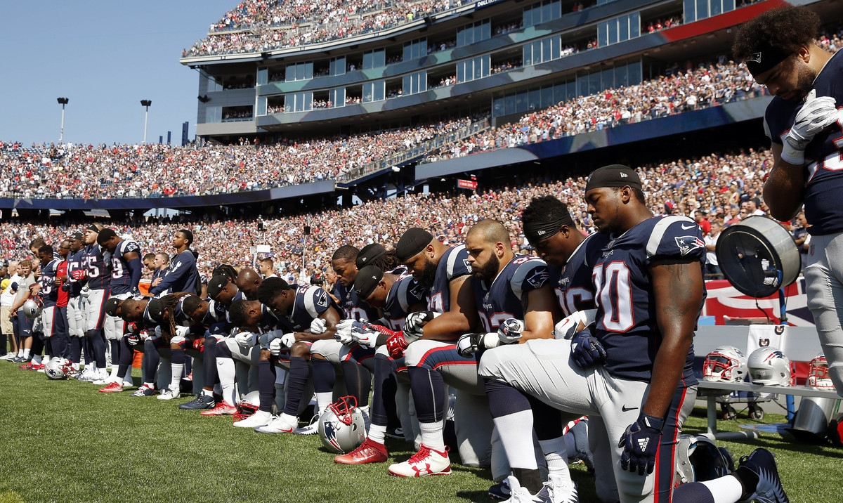 <b></b> Several New England Patriots players kneel during the national anthem before an NFL football game against the Houston Texans, Sunday, Sept. 24, 2017, in Foxborough, Mass. (AP Photo/Michael Dwyer)