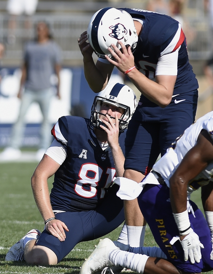 <b></b> UConn placekicker Michael Tarbutt, top, and holder Jay Rose react after Tarbutt missed a 35-yard field goal in the final seconds of Sunday's game against East Carolina at Rentschler Field in East Hartford. East Carolina won 41-38. (AP Photo/Jessica Hill)