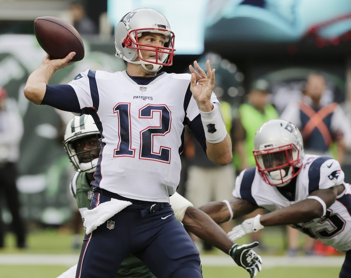 <b></b> Patriots quarterback Tom Brady throws a pass during the first half of Sunday's game against the Jets at East Rutherford, N.J. The Patriots won 24-17. (AP Photo/Seth Wenig)