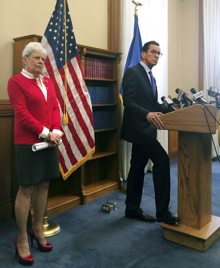 <b></b> Democratic Gov. Dannel P. Malloy, right, and Lt. Gov. Nancy Wyman speak with reporters, Monday, Oct. 16, 2017, in Hartford, Conn., about the fourth revised state budget that Malloy released Monday. Malloy said he hopes to help speed along closed-door budget talks between Democratic and Republican legislative leaders at the state Capitol. (AP Photo/Susan Haigh)