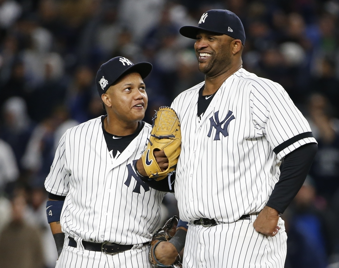 <b></b> Yankees second baseman Starlin Castro, left, shares a laugh with pitcher CC Sabathia during the sixth inning of Game 3 of the ALCS against the Astros on Monday at New York. (AP Photo/Kathy Willens)