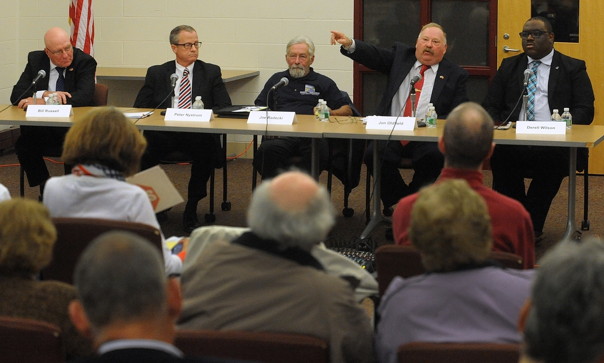<b></b> From left, Libertarian William Russell, Republican Peter Nystrom, petitioning candidate Joseph Radecki Jr., petitioning candidate Jon Oldfield and Democrat Derell Wilson during the Norwich mayoral debate at Kelly Middle School on Tuesday, Oct. 17, 2017.  (Dana Jensen/The Day)