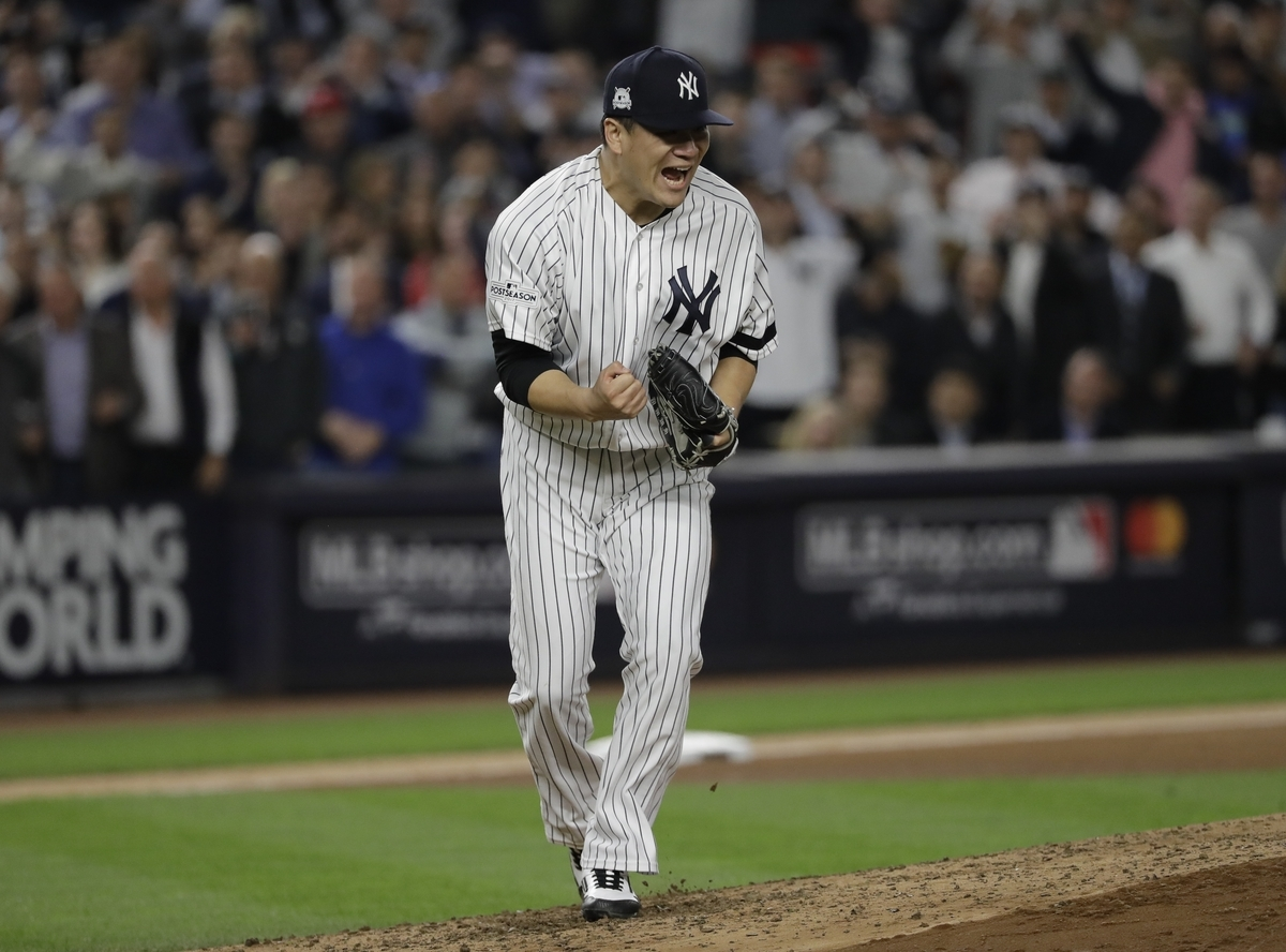 <b></b> New York Yankees starting pitcher Masahiro Tanaka reacts after striking out  Josh Reddick of the Houston Astros during the fifth inning of Game 5 of the American League Championship Series on Wednesday in New York. The Yankees won 5-1 to come within one game of a World Series appearance. (David J. Phillip/AP Photo)
