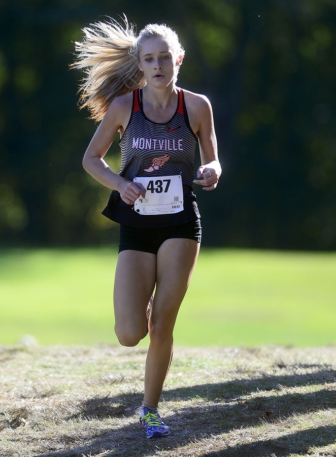 <b></b> Montville's Mady Whittaker holds a strong lead towards the end of the ECC girls' cross country championship meet on Thursday at the Norwich Golf Course. Whittaker won the individual title and East Lyme won the team title.  (Sarah Gordon/The Day)