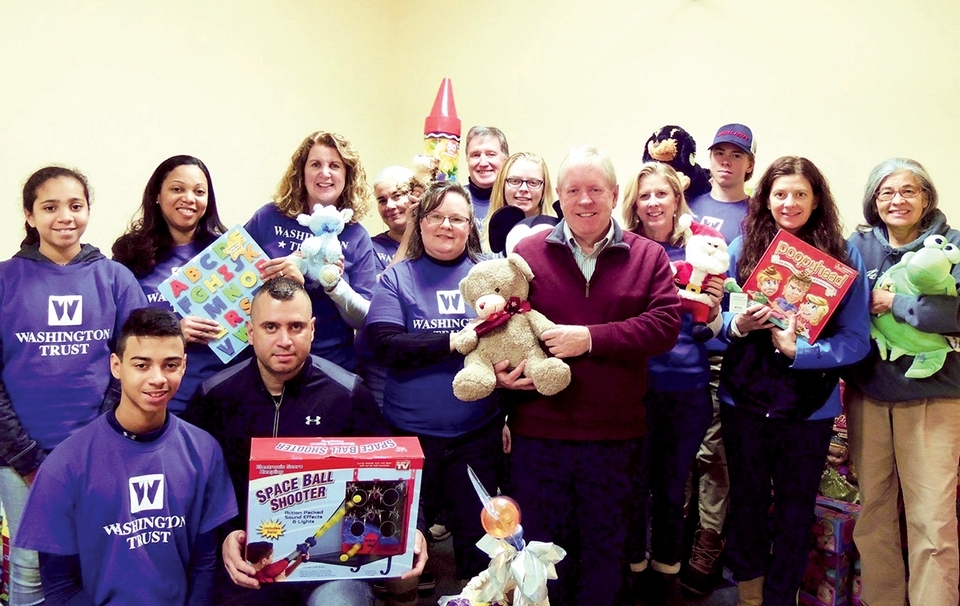 The Washington Trust team comes together to donate gifts for Adopt A Family at the Jonnycake Center. (Submitted photo)