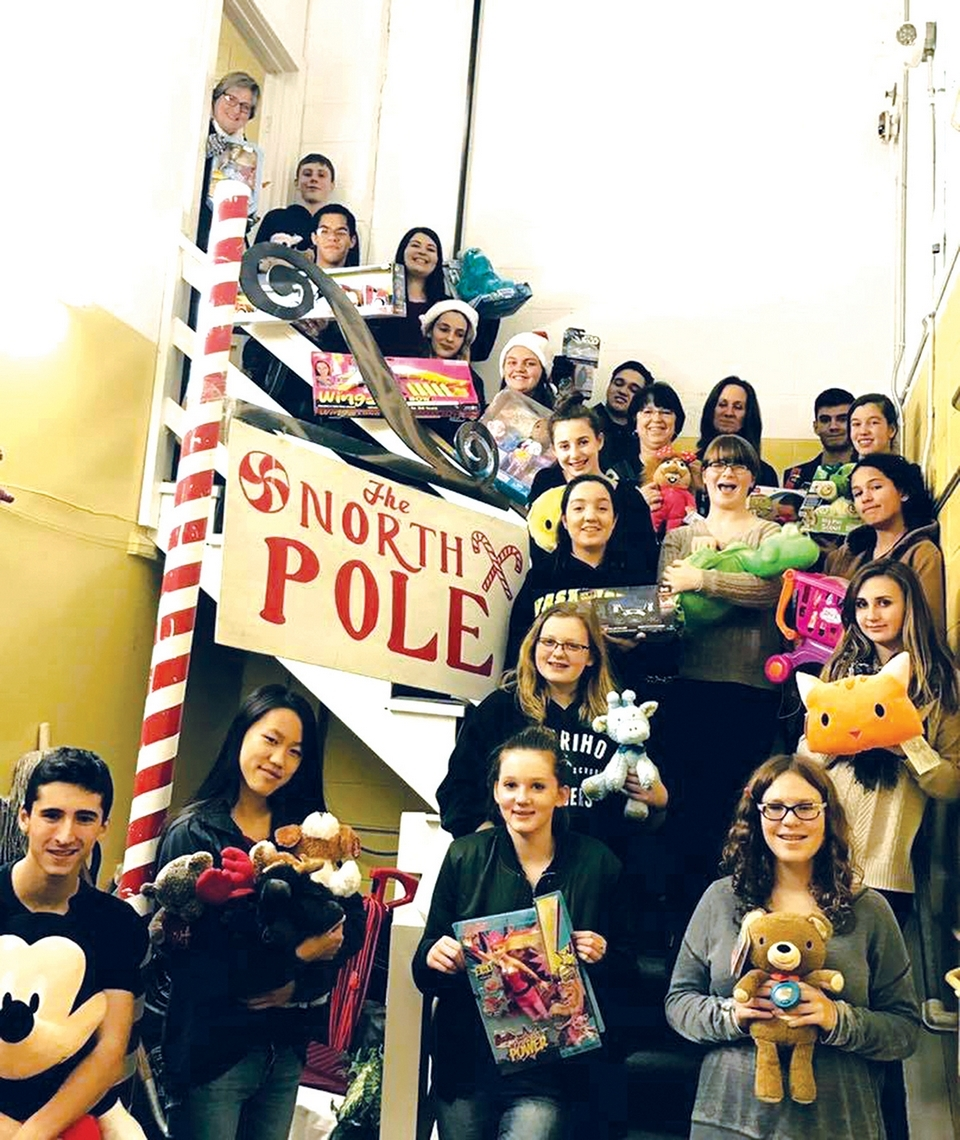 Chariho Rotary Club and Chariho High School Interact Club help prepare Adopt A Family donated gifts for Christmas distribution. (Submitted photo)