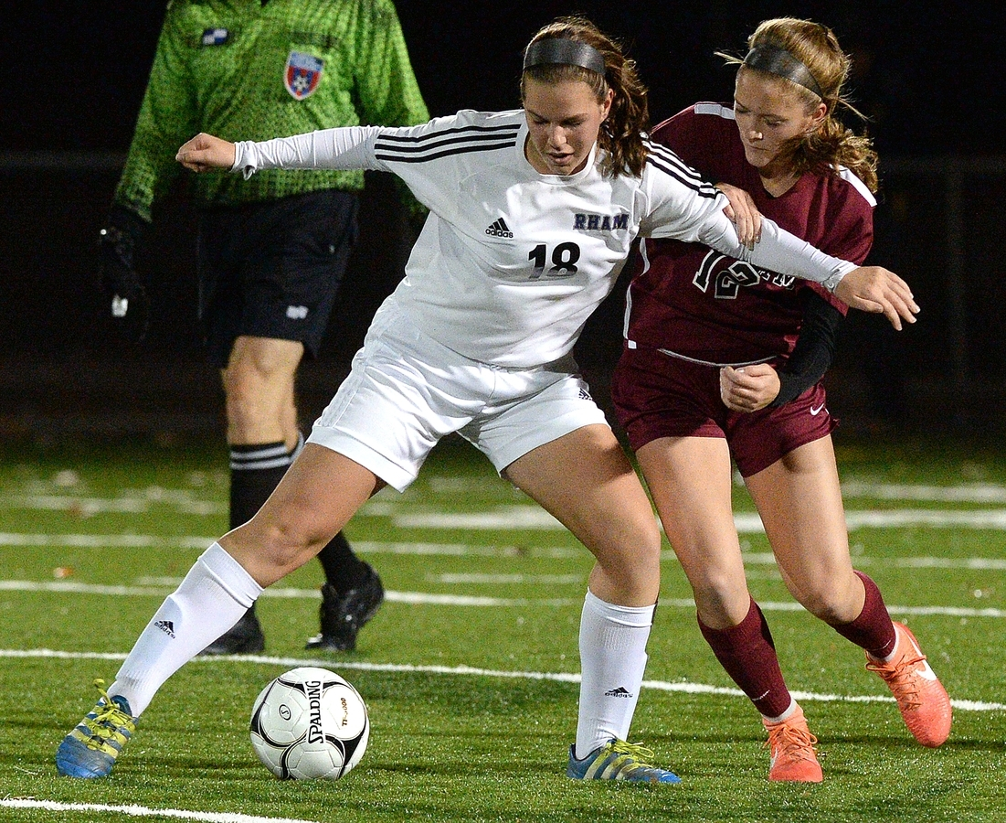 <b></b> East Lyme's Georgia Parsons, right, fights for control of the ball with RHAM's Rachel Purcell during Wednesday's Class L girls' soccer state tournament semifinal at Falcon Field in Meriden. Top-seeded RHAM won 3-0. (Dana Jensen/The Day)