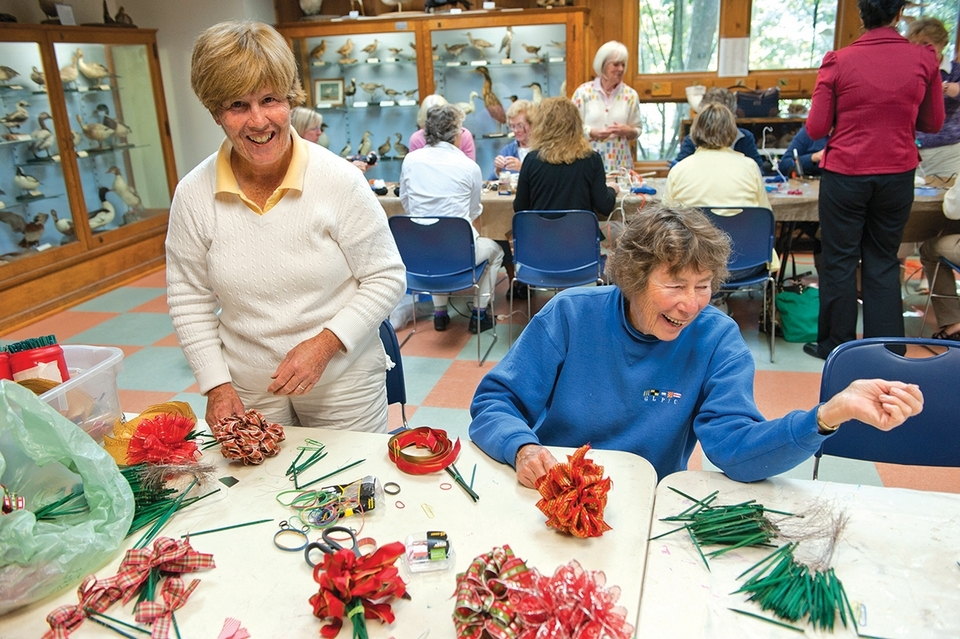 Carol Rooney, left, and Cynthia Mason fashion ribbons for the Mystic Garden Club's annual greens sale. (Peter M. Weber/Archive photo)